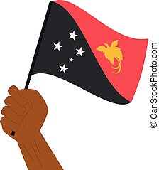 Hand holding and raising the national flag of Papua New...