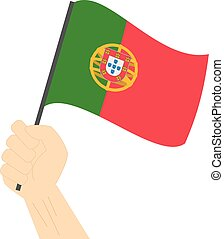 Hand holding and raising the national flag of Portugal