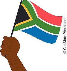 Hand holding and raising the national flag of South Africa