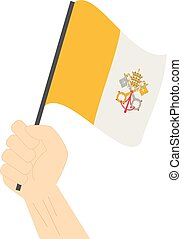 Hand holding and raising the national flag of Vatican City