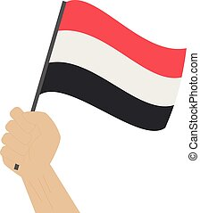 Hand holding and raising the national flag of Yemen