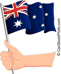 Hand holding and waving the national flag of Australia. Fans, independence day, patriotic concept. Vector illustration