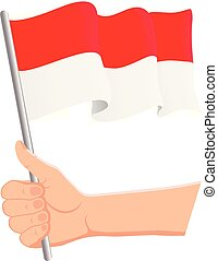 Hand holding and waving the national flag of Indonesia. Fans, independence day, patriotic concept. Vector illustration
