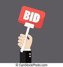 Hand holding auction paddle