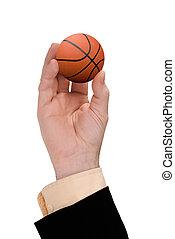 hand holding Basketball