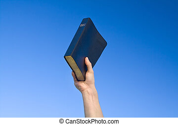 Hand Holding Bible