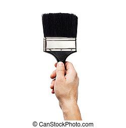 Hand holding big paintbrush isolated on white