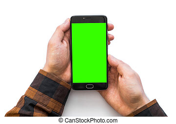 Hand holding black smartphone with green screen for chroma key compositing isolated on white background