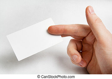 Hand holding blank business card over white