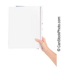 Hand holding blank magazine page - Hand holding magazine...