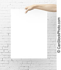 hand holding blank poster