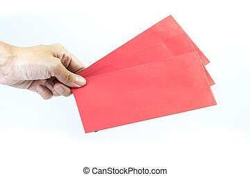 Hand holding blank red envelope on white background.