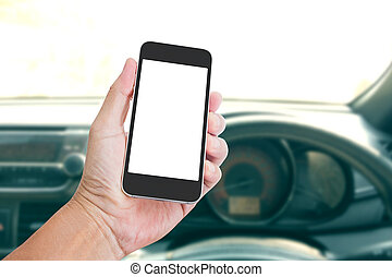 Hand holding blank screen mobile phone with Car inside background