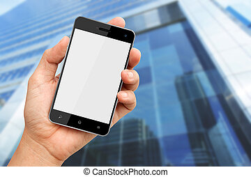 Hand holding blank screen smart phone with buiding...