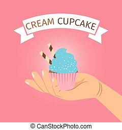 Hand holding blue cream cupcake