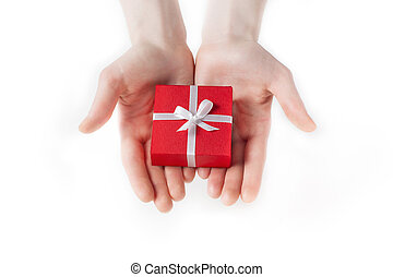 Hand holding box for a gift isolated on white