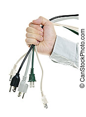 Hand holding bundle of power cables isolated on white...