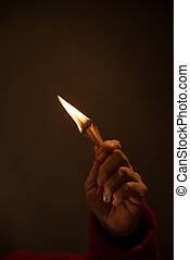 hand holding Burning Matches. studio shot,close up,