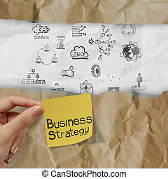 hand holding business strategy on crumpled paper background and sticky note as concept