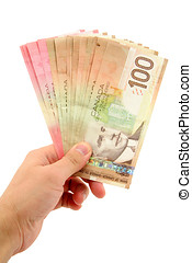 hand holding canadian dollars - canadian dollars with white...