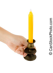 Hand holding candlesticks with yellow candle