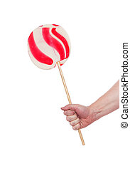 Hand holding candy cane lollipop