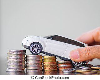 Hand holding car model