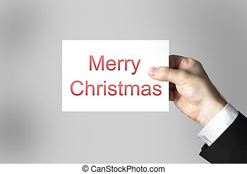 hand holding card merry christmas