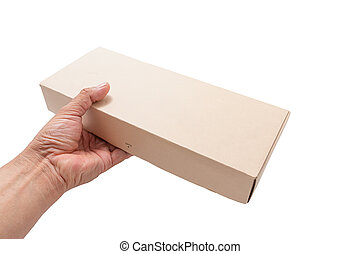 Hand holding cardboard box isolated on white background. The...