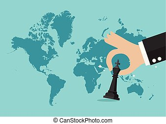 Hand holding chess figure with world map background