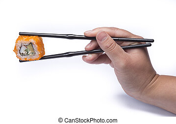 hand holding chopsticks eating sushi om white background
