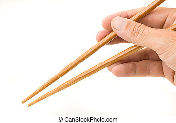 Hand holding chopsticks. - Hand holding chopsticks isolated...