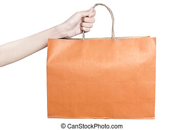 Hand holding colored shopping bag