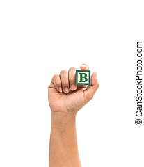 "Hand holding colorful alphabet blocks ""B"" isolated on white"