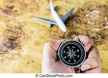 hand holding compass for vintage air travel plane
