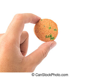 Hand holding cookie on white background