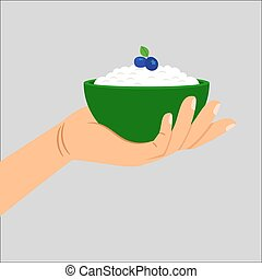 Hand holding cottage cheese with berry