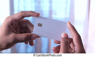 hand holding credit cards reading information .
