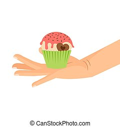 Hand holding cupcake with chocolate heart