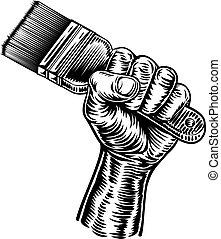 Hand Holding Decorators Paintbrush