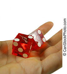 hand holding dice - a hand holding casino dice ready to...