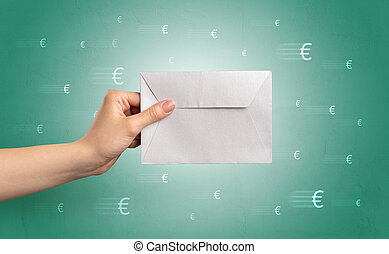 Hand holding envelope with symbols around