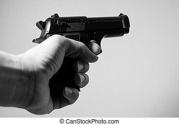 Hand holding firearm - Hand holding firearm, Black and white...