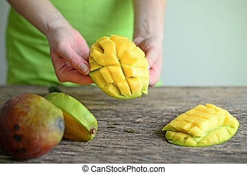 Hand Holding Fresh Mango , Cut in Square Shape Concept of Food Art, Idea of Decorated Food