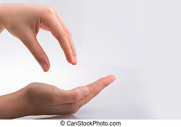 Hand holding gesture on a white background