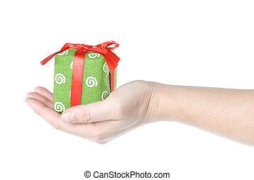 Hand holding gift isolated on white