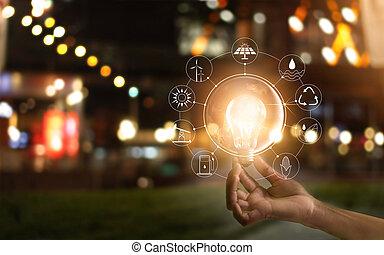 hand holding, glühlampe, vor, global, weisen, der, welt, verbrauch, mit, heiligenbilder, energie, quellen, für, erneuerbar, tragbar, development., ökologie, concept., elemente, von, dieser, bild, möbliert, per, nasa.