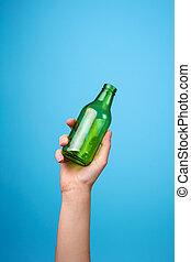 hand holding glass bottle