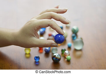 hand holding glass marble balls