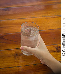 Hand holding Glass of water, glass of drink water.